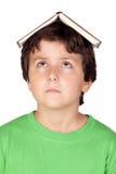Bambino dell'allievo con un libro Fotografia Stock Libera da Diritti