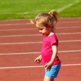Bambino della bambina allo stadio Immagini Stock Libere da Diritti