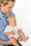 Bambino della holding del padre Immagine Stock