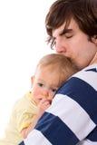Bambino della holding del padre Fotografie Stock