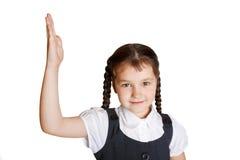 Bambino della scuola elementare che solleva la sua mano su Immagine Stock Libera da Diritti