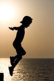 Bambino della siluetta Fotografie Stock Libere da Diritti