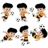 Bambino di calcio del fumetto con la posa differente Fotografie Stock