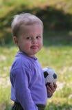 Bambino di gioco del calcio Immagine Stock