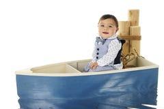Bambino di guida della barca Fotografia Stock Libera da Diritti