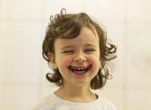 Bambino di risata Fotografia Stock