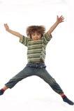 Bambino di salto Immagini Stock Libere da Diritti