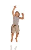Bambino di salto Immagini Stock