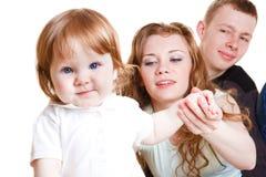 Bambino dolce con i genitori immagini stock libere da diritti
