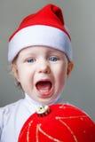 Bambino durante il nuovo anno 2015 del cappello di Santa Fotografia Stock