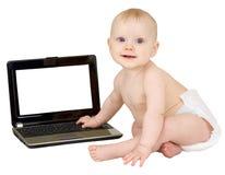 Bambino e computer portatile Fotografie Stock