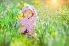 Bambino e fiori Fotografia Stock