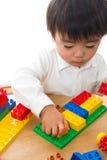 Bambino e giocattoli Immagine Stock Libera da Diritti
