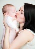 Bambino e madre immagine stock