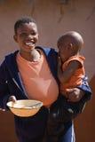 Bambino e madre africani Immagini Stock