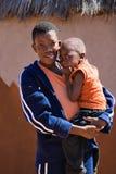 Bambino e madre africani Immagine Stock