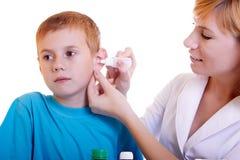 Bambino e medico Immagini Stock