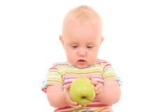 Bambino e mela Immagine Stock