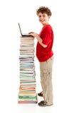 Bambino e mucchio dei libri Fotografie Stock