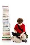 Bambino e mucchio dei libri Fotografia Stock
