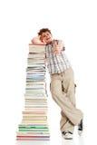 Bambino e mucchio dei libri - segno giusto Fotografia Stock Libera da Diritti