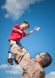 Bambino e padre militari Immagine Stock