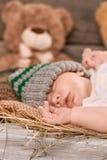 Bambino e paglia addormentati Fotografia Stock