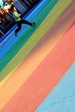 Bambino e Rainbow Immagine Stock