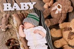 Bambino e teddybears addormentati Immagine Stock