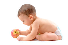 Bambino e un Apple Fotografia Stock