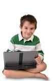 Bambino elementare con un computer portatile Immagine Stock Libera da Diritti