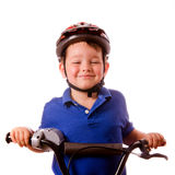 Bambino felice che guida la sua bici Immagini Stock Libere da Diritti