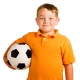Bambino felice con la sfera di calcio Immagini Stock