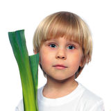 Bambino felice con la verdura verde Fotografia Stock
