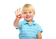 Bambino felice con le vernici a disposizione Fotografia Stock