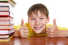 Bambino felice con libri Immagini Stock