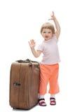 Bambino felice con un grande tronco Fotografia Stock