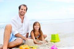 Bambino felice del castello della sabbia Immagine Stock Libera da Diritti