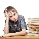 Bambino frustrato con le difficoltà di apprendimento Immagini Stock