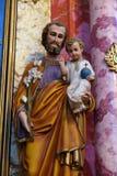 Bambino Gesù della tenuta di Saint Joseph Immagini Stock Libere da Diritti