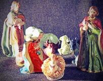 Bambino Gesù nella mangiatoia con un pastore Fotografia Stock Libera da Diritti