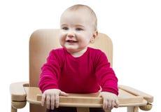 Bambino in giovane età che si siede nell'alta presidenza Immagini Stock Libere da Diritti