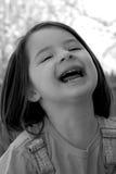 Bambino-Grande risata fotografia stock