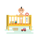 Bambino in greppia con i giocattoli illustrazione di stock