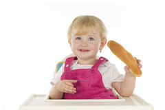 Bambino il suo pane. Fotografia Stock