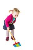 Bambino infantile della ragazza con una scopa Fotografie Stock Libere da Diritti