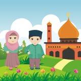 Bambino islamico del fumetto con la moschea ed il paesaggio illustrazione di stock