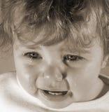 Bambino lacrimoso immagini stock