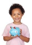 Bambino latino felice con un moneybox blu Fotografia Stock Libera da Diritti