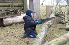 Bambino lavorante Fotografia Stock Libera da Diritti